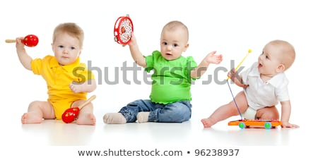 three young children playing in studio stock photo © monkey_business