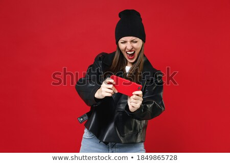 Screaming young woman wearing virtual reality device Stock photo © deandrobot