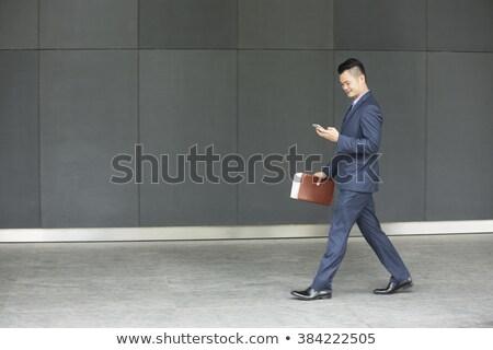 vista · lateral · Asia · hombre · caminando · guapo - foto stock © szefei