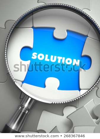 Stock photo: Decision - Puzzle with Missing Piece through Loupe.