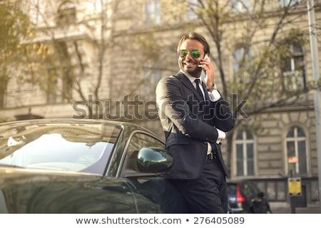 Confident businessman in sunglasses. Stock photo © RAStudio