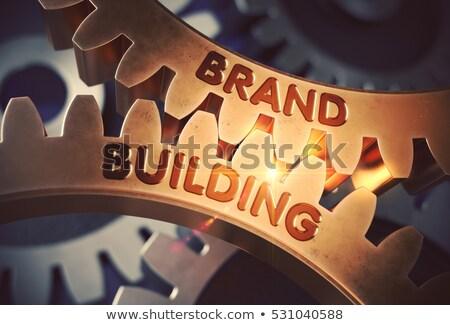 Márka épület arany sebességváltó mechanizmus fémes Stock fotó © tashatuvango
