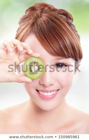Nina kiwi rebanadas sonriendo alimentos Foto stock © IS2