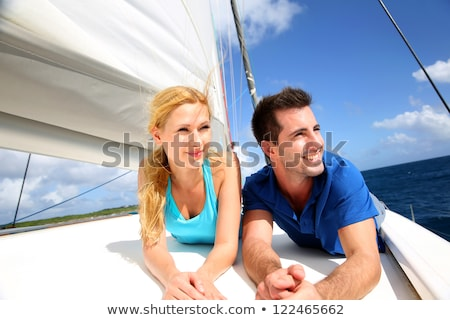 Cheerful couple relaxing on the boat Stock photo © majdansky
