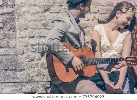 man playing guitar to woman Stock photo © IS2