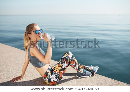 Woman drinking water and resting while jogging in the park Stock photo © vlad_star