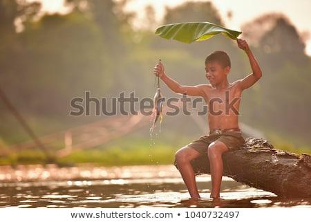 Asian boy fishing outdoors Stock photo © palangsi