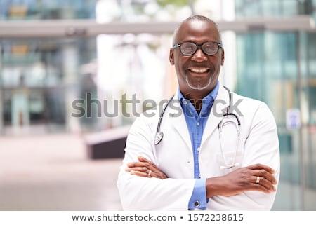 портрет · счастливым · мужской · доктор · равномерный · стетоскоп · мобильного · телефона - Сток-фото © deandrobot