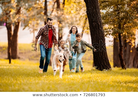 Mother and two girls walking with a dog in the autumn park Stock photo © boggy