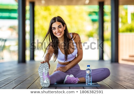 woman stretching before exercise stock photo © is2