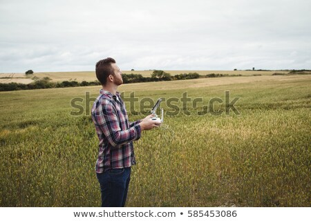 Farmer using agricultural device while examining in field Stock photo © wavebreak_media