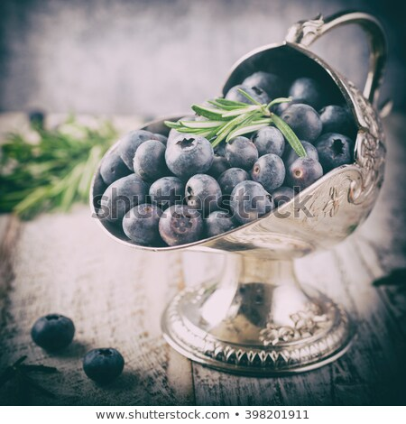 Fresh blueberries in vintage metal sugar bowl Stock photo © Melnyk
