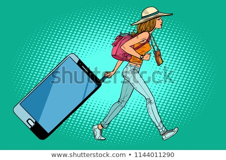 Woman traveler with a smartphone. Gadget instead of Luggage Stock photo © rogistok