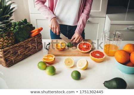 Közelkép fiatal háziasszony eszik friss gyümölcs saláta Stock fotó © dashapetrenko
