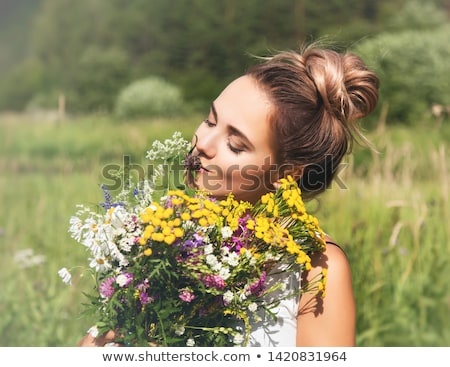 Natural beauty girl with bouquet of flowers outdoor in freedom enjoyment concept. Stock photo © artfotodima