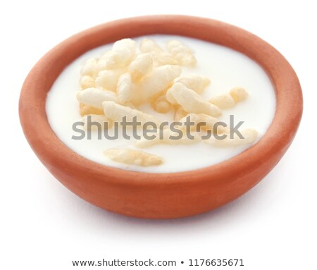Fresh milk in a clay pottery with puffed rice Stock photo © bdspn