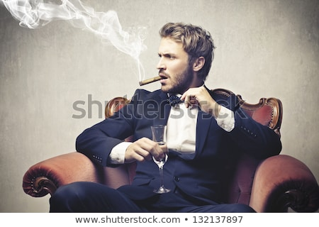 Rich businessman drinks wine and smoks cigar Stock photo © boggy