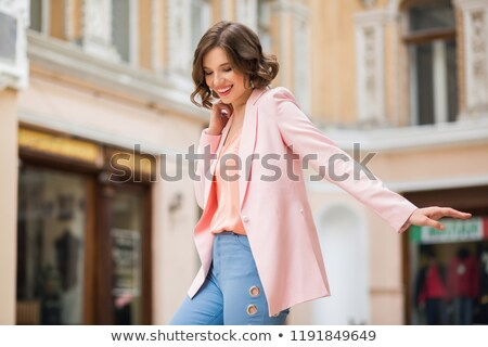 Vonzó nő rózsaszín ruházat pózol fehér fából készült Stock fotó © acidgrey