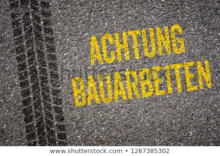 Lane with the German Translation of Caution Road work - Achtung  Stock photo © Zerbor