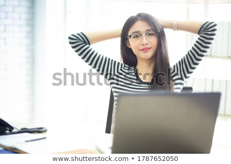 portrait of a pretty secretary sitting at her desk stock photo © minervastock
