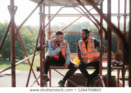 Happy Workers In Construction Site During Lunch Break Stock photo © diego_cervo