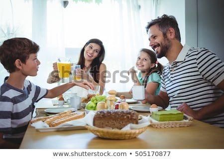 happy family having breakfast at home stock photo © dolgachov