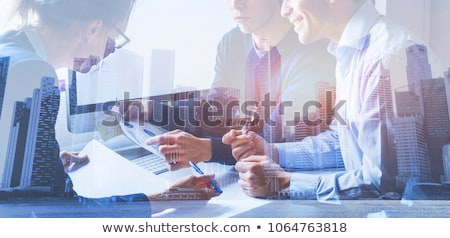 Team of business person works together. Concept of teamwork. Double exposure with internet connectio Stock photo © alphaspirit