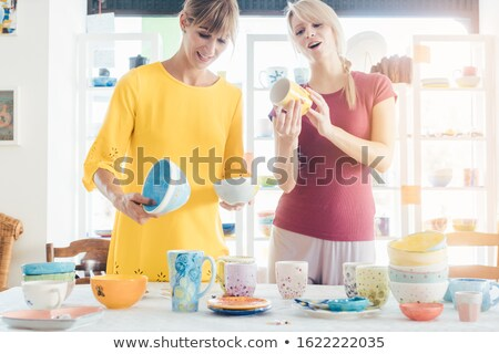 Women buying ceramic dishes in a workshop Stock photo © Kzenon