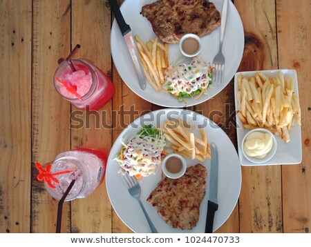 vegetables meat steak and sweet soda on table stock photo © robuart