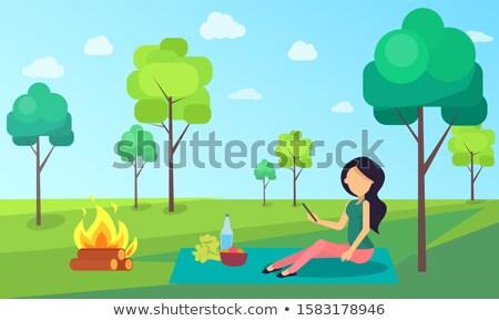 Picnic of Woman Sitting on Cloth Nature Greenery Stock fotó © robuart