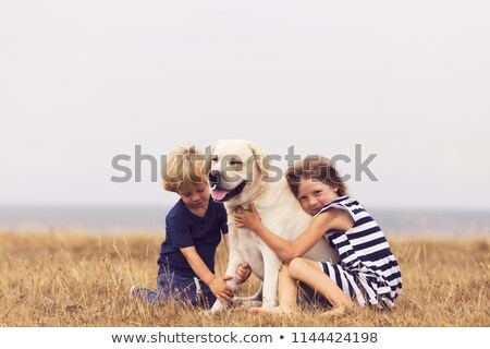 Boy and Girl Walk their Dog at Garden Stock photo © colematt