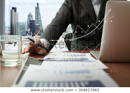 üzletember · dolgozik · tabletta · diagram · grafikon · adat - stock fotó © Freedomz