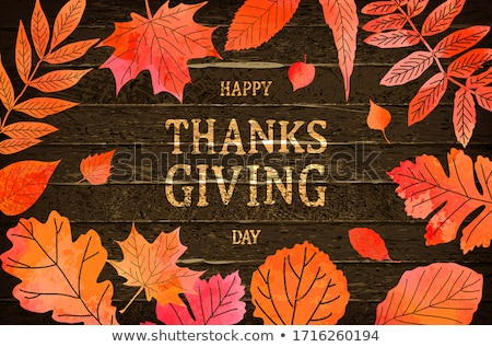 thanksgiving holiday banner with congratulation text autumn tree leaves on wooden background autum stock photo © ikopylov