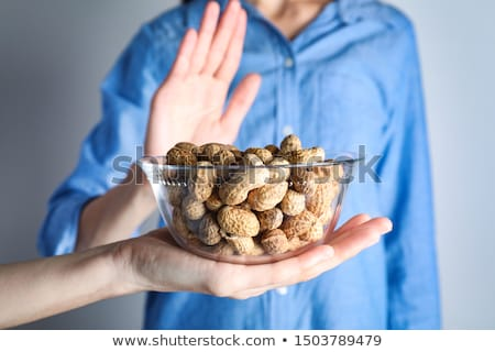woman refusing bowl of nut food stock photo © andreypopov