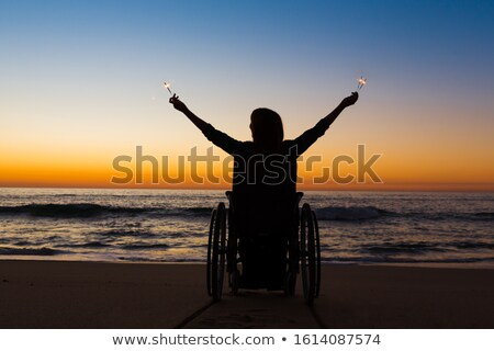 Handicapped woman holding fire sparklers Stock photo © iko