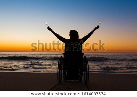 vrouw · rolstoel · strand · gehandicapten · alleen · zandstrand - stockfoto © iko