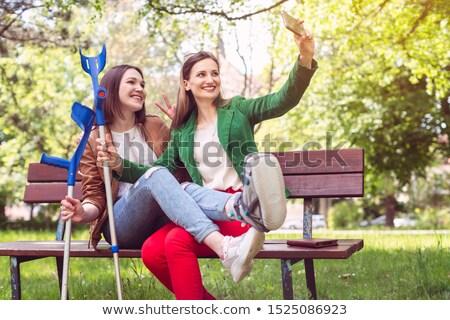 best friends with one having a broken leg taking a selfie stock photo © kzenon