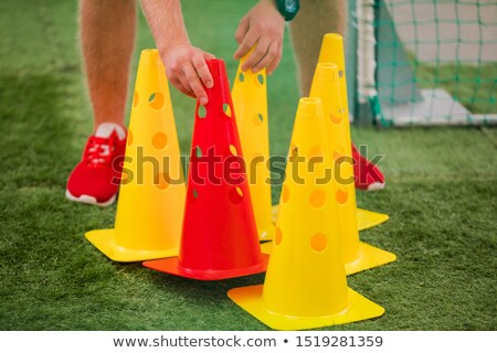 soccer coach preparing training cones agility fitness and power stock photo © matimix