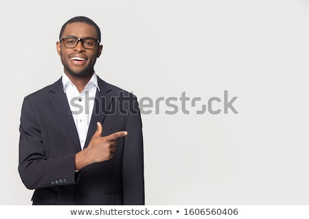 Friendly businessman showing blank space for text. Stock photo © lichtmeister