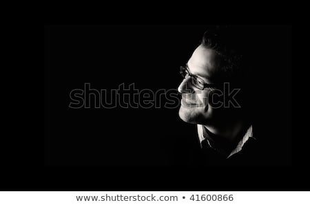 Low key portrait of young attractive man looking up. Stock photo © lichtmeister