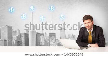 Announcer presenting the city energy consumption Stock photo © ra2studio
