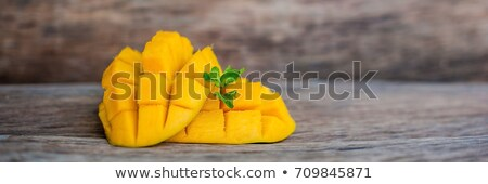 banner mango fruit and mango cubes on the wooden table tropical fruit concept long format stock photo © galitskaya