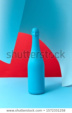 Holiday wine mock-up bottle painted blue with soft shadows. Stock photo © artjazz