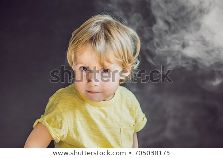 Passive smoking concept. The boy turns his face away from the cigarette smoke Stock photo © galitskaya
