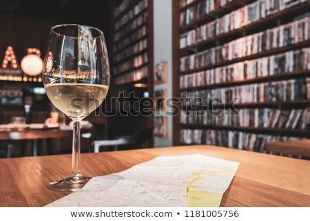 Polc könyvek bor üvegek borospoharak otthon Stock fotó © robuart