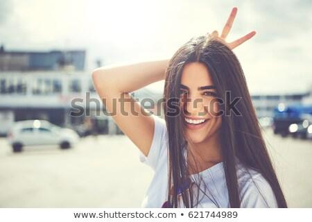 Obraz zabawny młoda kobieta uśmiechnięty zabawy Zdjęcia stock © deandrobot