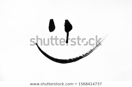 smiling female with dramatic eye makeup stock photo © lovleah