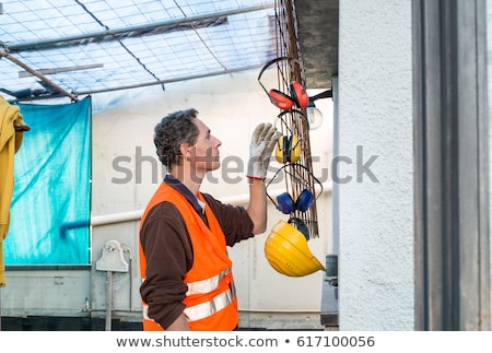 Man wearing reflective jacket and hearing protection Stock photo © photography33