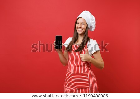 Chef holding a mobile phone Stock photo © photography33
