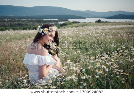 woman and daisy stock photo © imarin